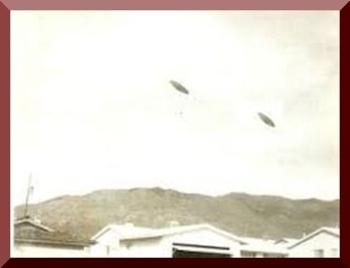 Farmer & Wife See 2 UFOs