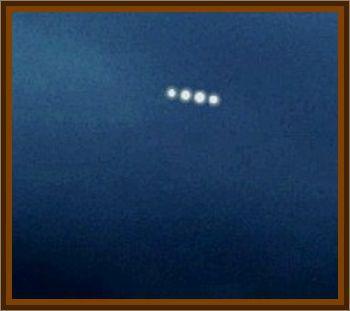 Silver/Blue Object Zips Across Sky