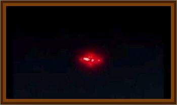 Two Patrolmen See Glowing Red UFO